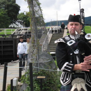 Spud the Bagpiper in Scotland
