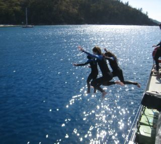 Jumping off Boat in the Whitsunday Islands Australia