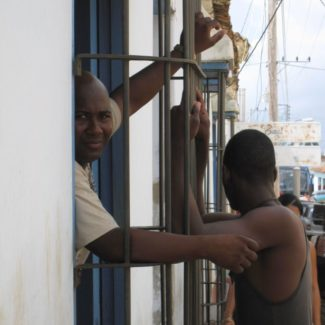 Cuban Men Hanging Out of Window