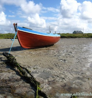 beached boat in the sand ireland